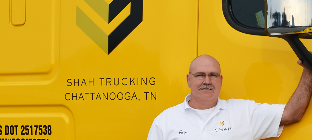 truck-driver-in-front-of-yellow-shah-truck