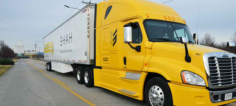 yellow-18-wheeler-with-shah-logo